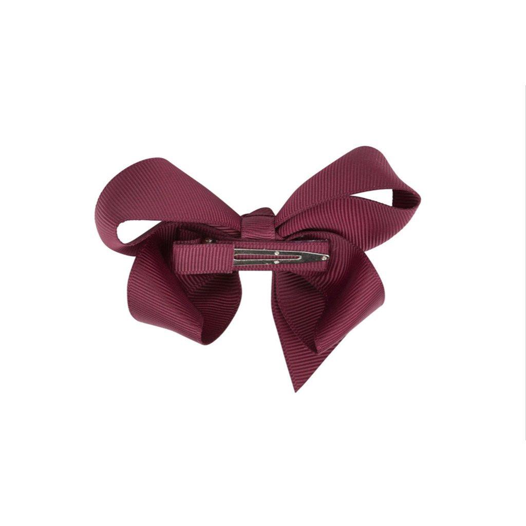 by stær sløjfe bordeaux i mellem (8 cm). Brug den som almindelig hårspænde eller til at pifte dit CIHA pandebånd op.